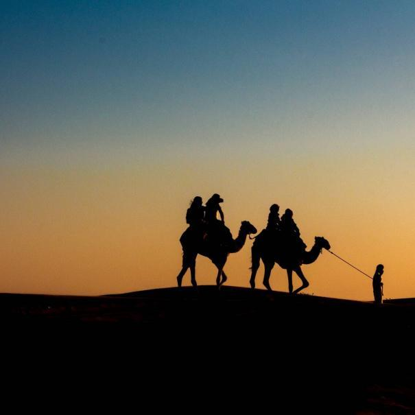 sunset in the desert with Touring In Morocco
