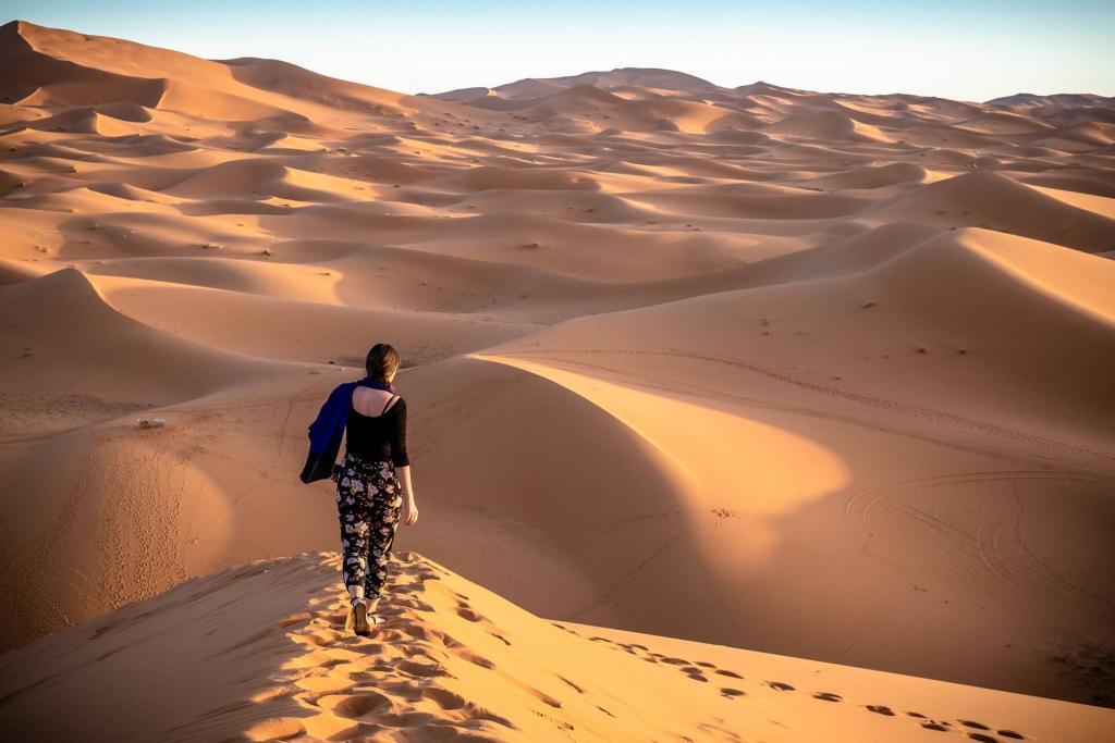 A solo woman in the Sahara desert